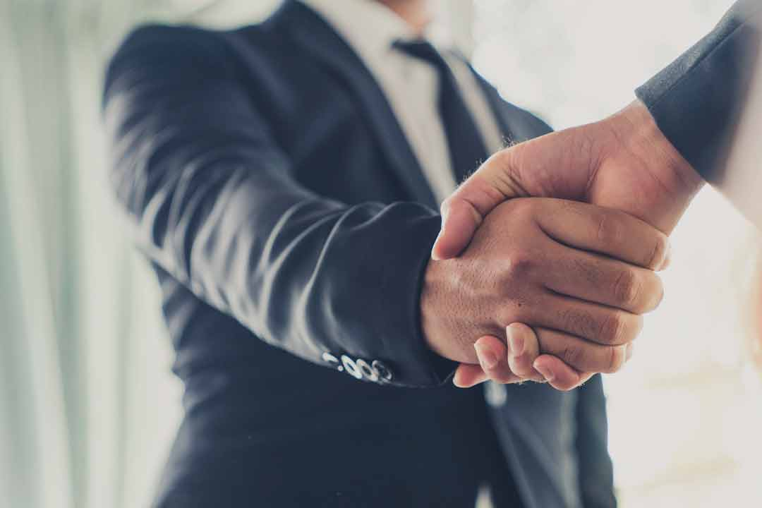 Man in Business Suit shaking Client's Hand
